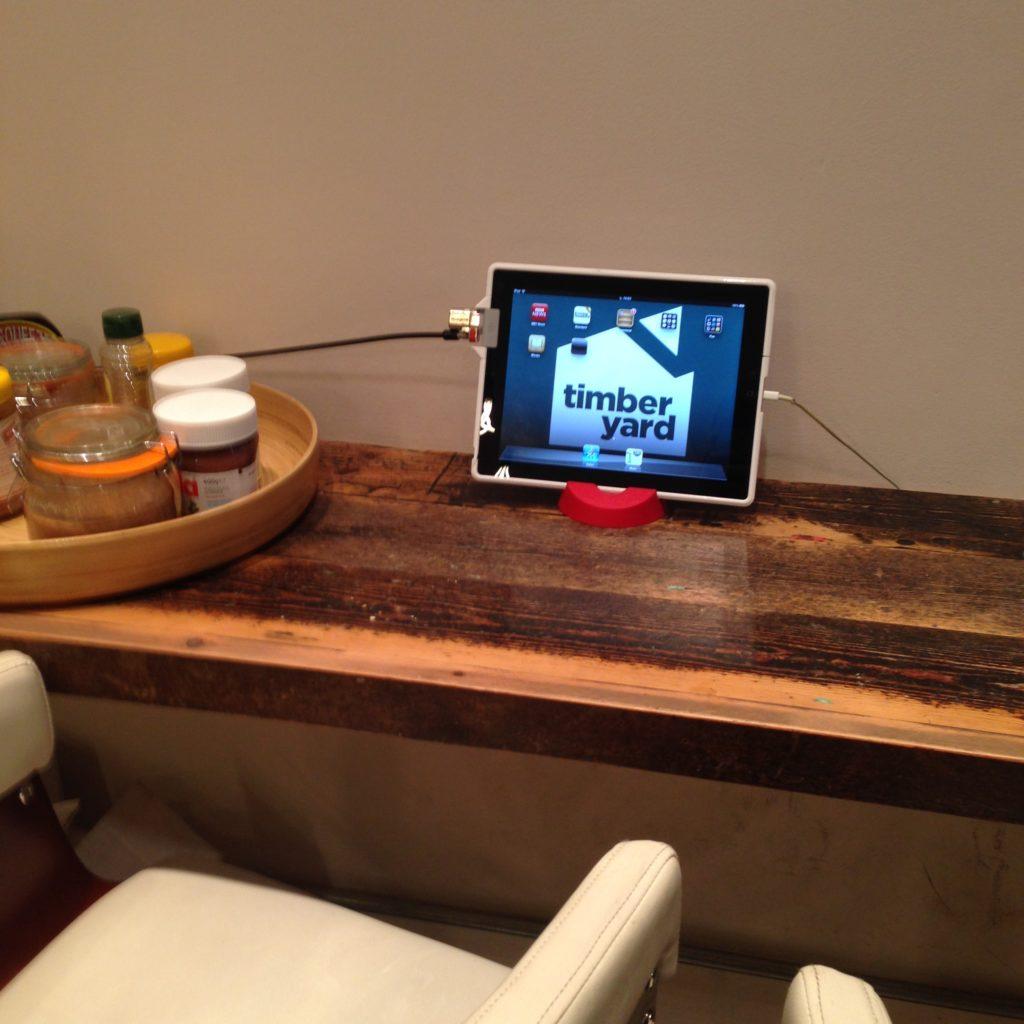 An branded ipad on a bar table, ready for use
